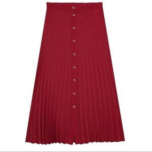 Midi pleated skirt with front buttons